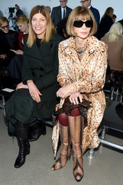 Anna Wintour sat front row at the Calvin Klein fashion show looking glam in a leopard-print fur coat.