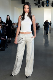 Kendall Jenner topped off her monochromatic ensemble with a pale-gray Calvin Klein clutch.