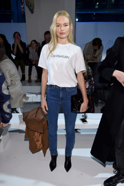 Kate Bosworth kept it casual and simple in a white Calvin Klein logo tee during the label's fashion show.