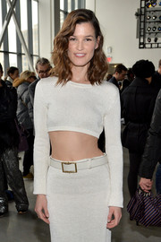 Hanneli Mustaparta attended the Calvin Klein fashion show wearing a sexy pencil skirt/crop-top combo, which she styled with a white leather belt.