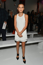 Millie Bobby Brown completed her outfit with a pair of black broad-strap pumps by Kurt Geiger.