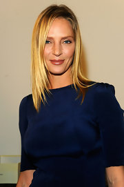 At the Calvin Klein Spring 2012 fashion show, Uma Thurman wore a lovely caramel shade of lipstick that popped next to her vivid blue dress.