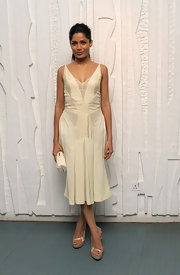 Freida Pinto donned a sweet ivory frock paired with gold strappy sandals.