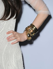 These gold bangle braclets add just the right amount of flare to China's shear frock.