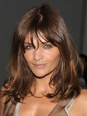 Brunette bombshell Helena Christensen displayed her chestnut colored hair while attending fashion week. The warm color looked great on her olive color skin.