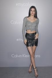 Kendall Jenner amped up the allure with a black leather mini skirt, also by Calvin Klein.