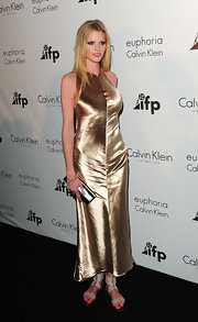 Lara wore an ankle-length gold dress for the Calvin Klein party at Cannes.