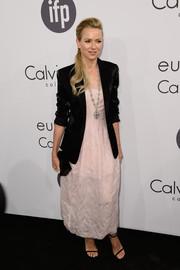 Naomi Watts arrived for the Calvin Klein party wearing a fitted black blazer over a pink dress.