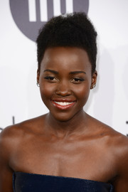 Lupita Nyong'o wore her natural curls high at the crown when she attended the Calvin Klein party in Cannes.