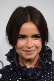 Miroslava Duma attended the Calvin Klein party in Cannes wearing a loose center-parted updo.