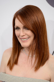 Julianne Moore finished off her look with a super-sleek side-parted hairstyle when she attended the Calvin Klein party in Cannes.