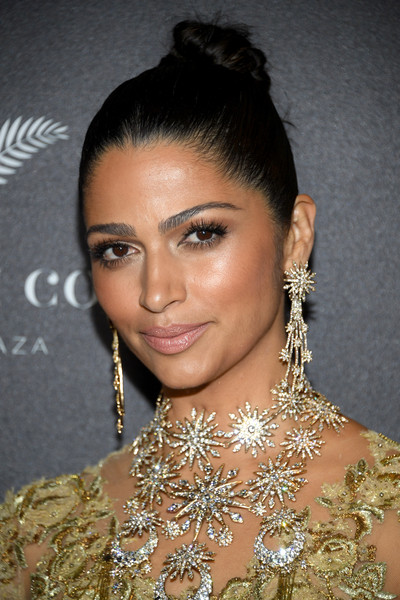 Camila Alves Hair Knot [twc-dimension hosts the world premiere of gold,hair,hairstyle,eyebrow,beauty,jewellery,shoulder,black hair,chignon,lip,bun,camila alves,gold,theater,new york city,lincoln square,red carpet,twc - dimension,amc loews,the world premiere]