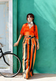 Camila Cabello donned an orange Diane von Furstenberg cropped blouse with flutter sleeves for the launch of her HAVANA makeup collection.