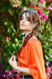 Camila Cabello rocked an orange-streaked braid at the launch of her HAVANA makeup collection.