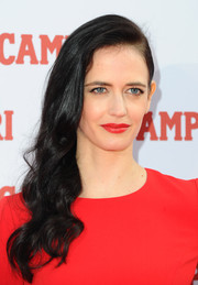 Eva Green matched her outfit with a vibrant red lip.