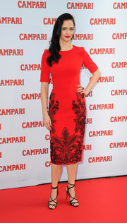 Eva Green kept it modest yet elegant at the Campari Calendar launch in a red sheath dress with swirly embroidery on the skirt.