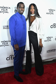 Naomi Campbell made an appearance at the Tribeca Film Fest premiere of 'Can't Stop, Won't Stop' wearing a plunging white peasant blouse.