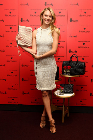 Candice Swanepoel Leather Clutch [red,clothing,dress,blond,shoulder,fashion,office equipment,cocktail dress,flooring,room,bottletop,narciso rodriguez,candice swanepoel,candace swanepoel launches,collaboration,london,england,harrods]