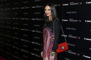 Georgina Chapman accessorized with an elegant red chain-strap bag when she attended the screening of 'A Dream of Flying' in NYC.