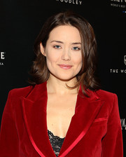 Megan Boone attended the Capitol File holiday issue celebration wearing her hair in a messy-chic flip.