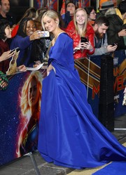 Brie Larson looked opulent in a royal-blue cape by Valentino Couture at the 'Captain Marvel' European gala premiere.