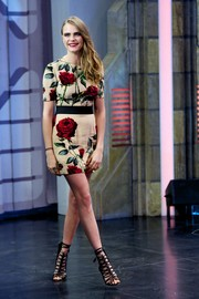 Cara Delevingne looked simply lovely in her rose-print mini dress while visiting the 'El Hormiguero' TV show.