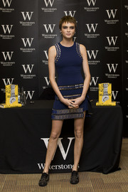 Cara Delevingne complemented her dress with a pair of studded oxfords by The Kooples.
