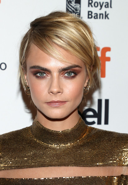 Cara Delevingne Messy Cut [hair,face,hairstyle,blond,eyebrow,lip,chin,beauty,forehead,hair coloring,cara delevingne,her smell,toronto,canada,winter garden theatre,toronto international film festival,premiere]