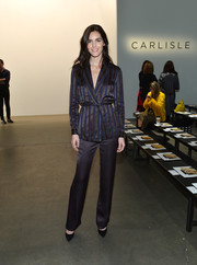 Hilary Rhoda was all about easy sophistication in a striped satin pantsuit at the Carlisle fashion show.