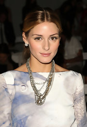 Olivia Palermo gave her dress an edgy twist with a layered chain necklace.