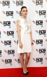 Rooney Mara got all dolled up in a white ruffle cocktail dress by Giambattista Valli for the BFI London Film Fest photocall for 'Carol.'