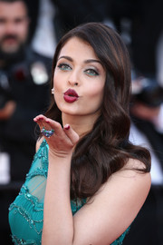 Aishwarya Rai swiped on some aqua-green liner along her lower lids to match her gown.