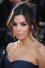Eva Longoria matched her blue gown with a gorgeous pair of Lorraine Schwartz sapphire studs.