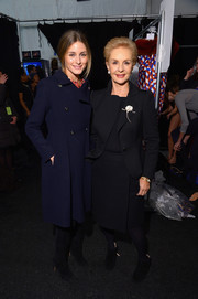 Olivia Palermo kept it classic in a double-breasted navy wool coat by Carolina Herrera when she attended the brand's fashion show.