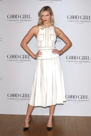 Karlie Kloss looked playfully stylish in this sleeveless white cutout dress by Carolina Herrera during the Good Girl fragrance launch.