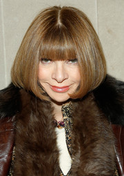 Anna Wintour sat front row at the Carolina Herrera fashion show wearing her usual bob with blunt bangs.