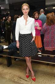 Nicky Hilton Rothschild punctuated her monochrome outfit with a pair of red pumps by Alice + Olivia.