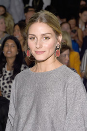 Olivia Palermo looked red carpet-ready with her luxe dangling gemstone earrings at the Carolina Herrera fashion show.
