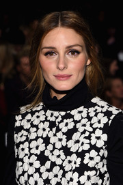Olivia Palermo attended the Carolina Herrera fashion show wearing her locks in a very loose ponytail.