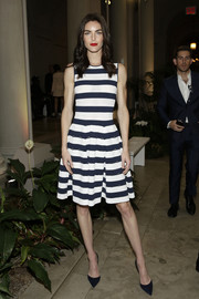 Hilary Rhoda went for easy elegance in a navy and white fit-and-flare dress when she attended the Carolina Herrera fashion show.