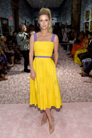 Nicky Hilton looked dazzling in a canary-yellow Carolina Herrera dress with a purple waistband and shoulder straps during the brand's Spring 2019 show.