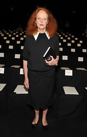 Grace Coddington wore a stylish long black dress with an exaggerated white collar to the Carolina Herrera Spring 2012 fashion show.