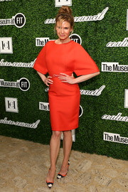 Renee Zellweger donned a red Carolina Herrera sheath dress with roomy sleeves for the Couture Council Award luncheon.