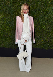 Rachel Zoe teamed a bubblegum-pink Chanel blazer with a white ruffle blouse and wide-leg pants for the Gabrielle bag celebration.