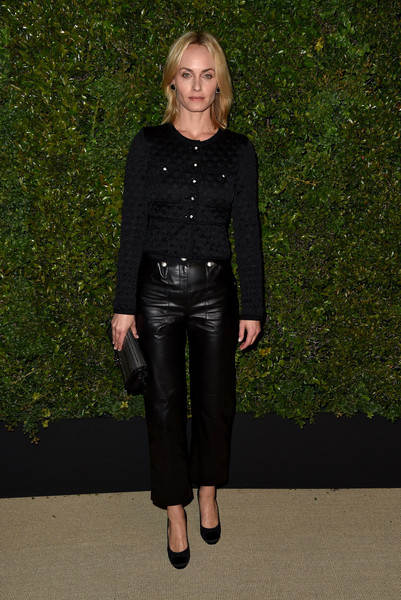 Amber Valletta kept it classy in a textured silk cardigan by Chanel at the Gabrielle bag celebration.