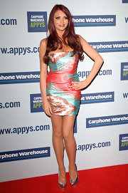 Amy Childs slipped on a pair of metallic silver pumps featuring silver spikes for the 2012 Carphone Warehouse Appy Awards.