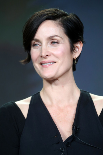 Carrie-Anne Moss Short Side Part [series,hair,face,hairstyle,chin,eyebrow,white-collar worker,black hair,official,smile,long hair,winter tca,carrie-anne moss,humans,hair,hair,hairstyle,face,raw beauty talks,portion,carrie-anne moss,stock photography,getty images,raw beauty talks,photography,royalty-free,humans,celebrity]