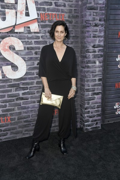 Carrie-Anne Moss Jumpsuit [season,clothing,shoulder,fashion,dress,footwear,neck,fashion design,street fashion,photography,little black dress,arrivals,jessica jones,carrie-anne moss,arclight hollywood,california,netflix,screening]