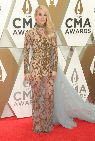 Carrie Underwood Sheer Dress [red carpet,carpet,clothing,fashion model,dress,fashion,flooring,hairstyle,premiere,long hair,arrivals,carrie underwood,cma awards,nashville,tennessee,music city center]