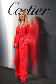 Annabelle Wallis caught eyes in a bright red pantsuit by Antonio Berardi at the Santos de Cartier watch launch.